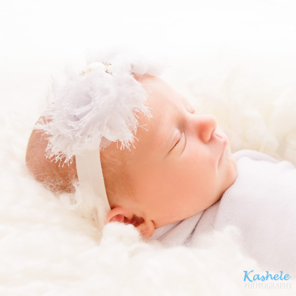 Backlit shot of baby's profile for utah newborn photographer post