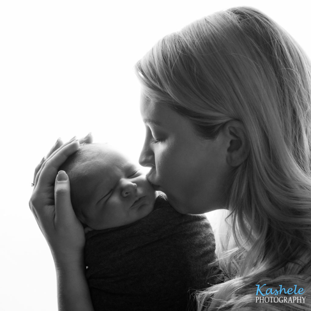 Backlit Image of Mommy kissing baby