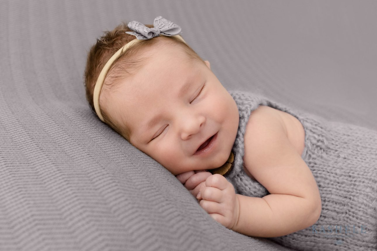 Smiling baby for for Newborn Photography Cost Post
