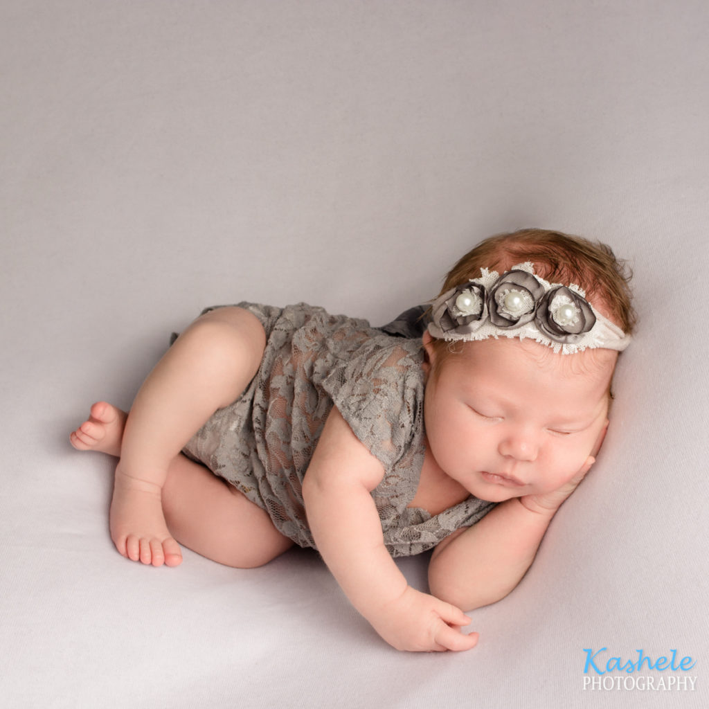 Side pose for Utah County Newborn Photography Post