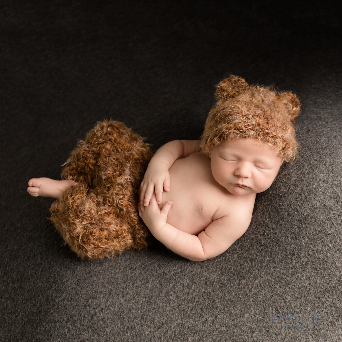 Image of baby boy in Huggalugs bear set doing Huck Finn pose