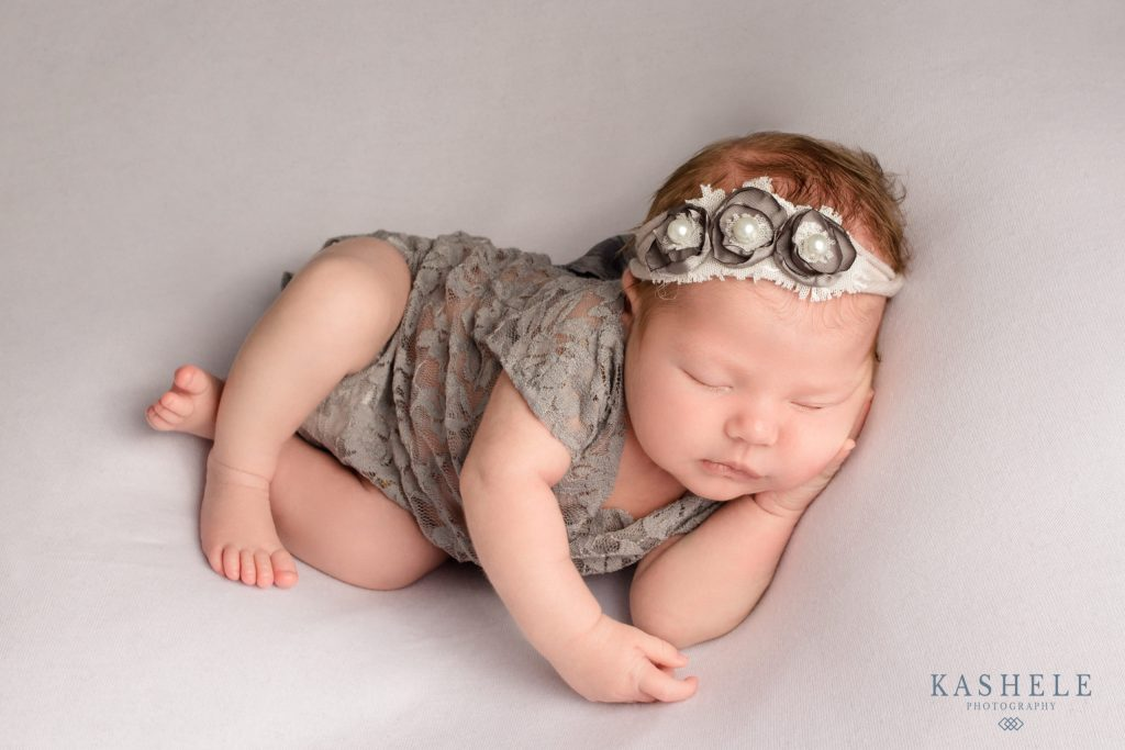 Newborn photography utah image of baby girl in side pose