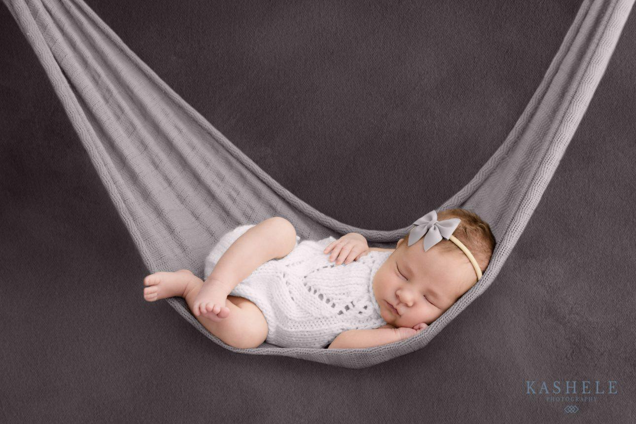Image of baby girl in hammock pose