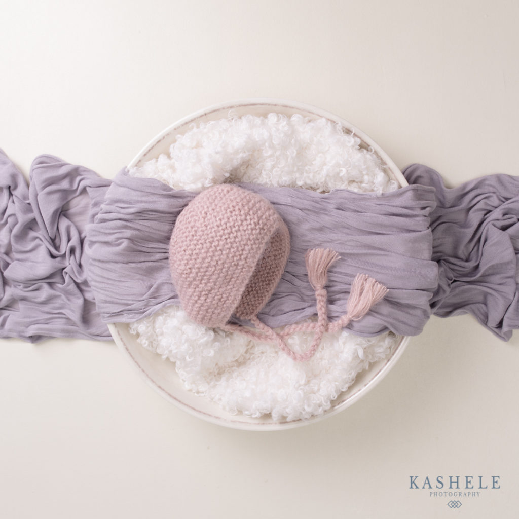 Flatlay image of Huggalugs newborn pink Angora bonnet