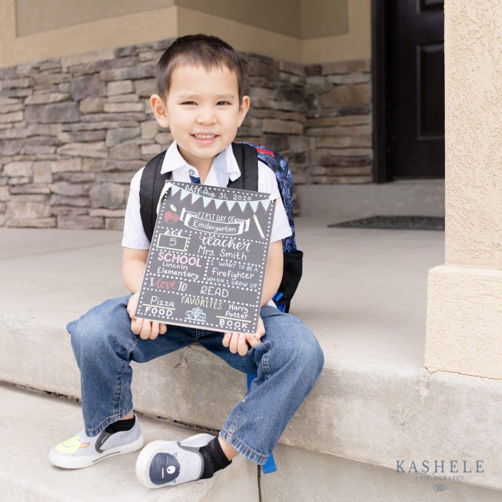 first day of school pictures with back to school chalkboard sign