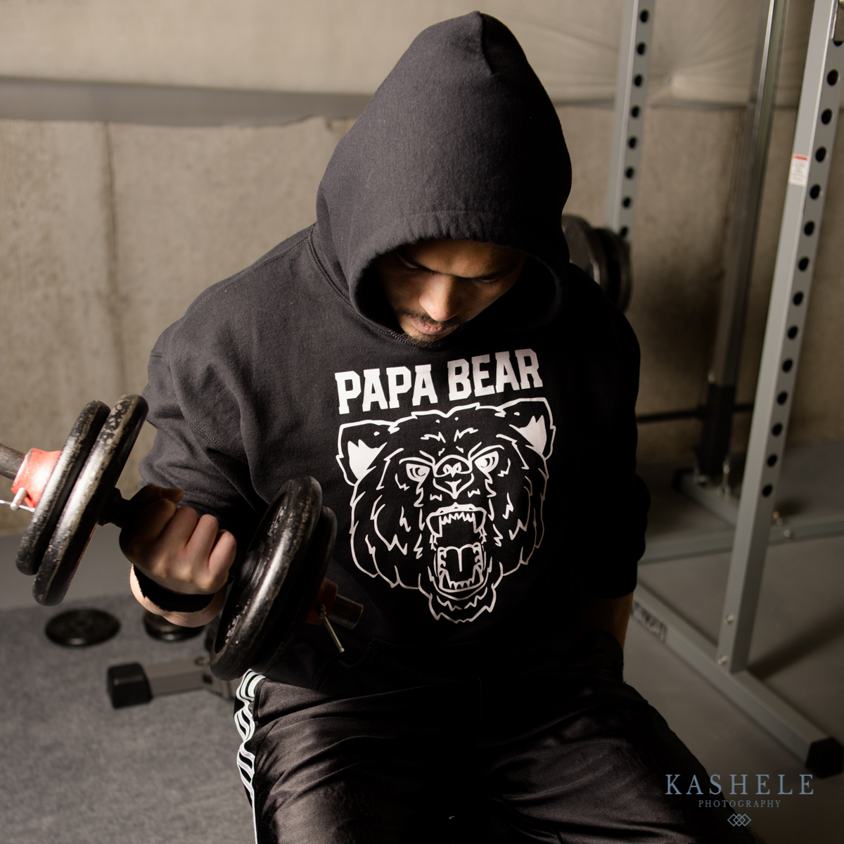 Man doing bicep curl in papa Bear hoodie