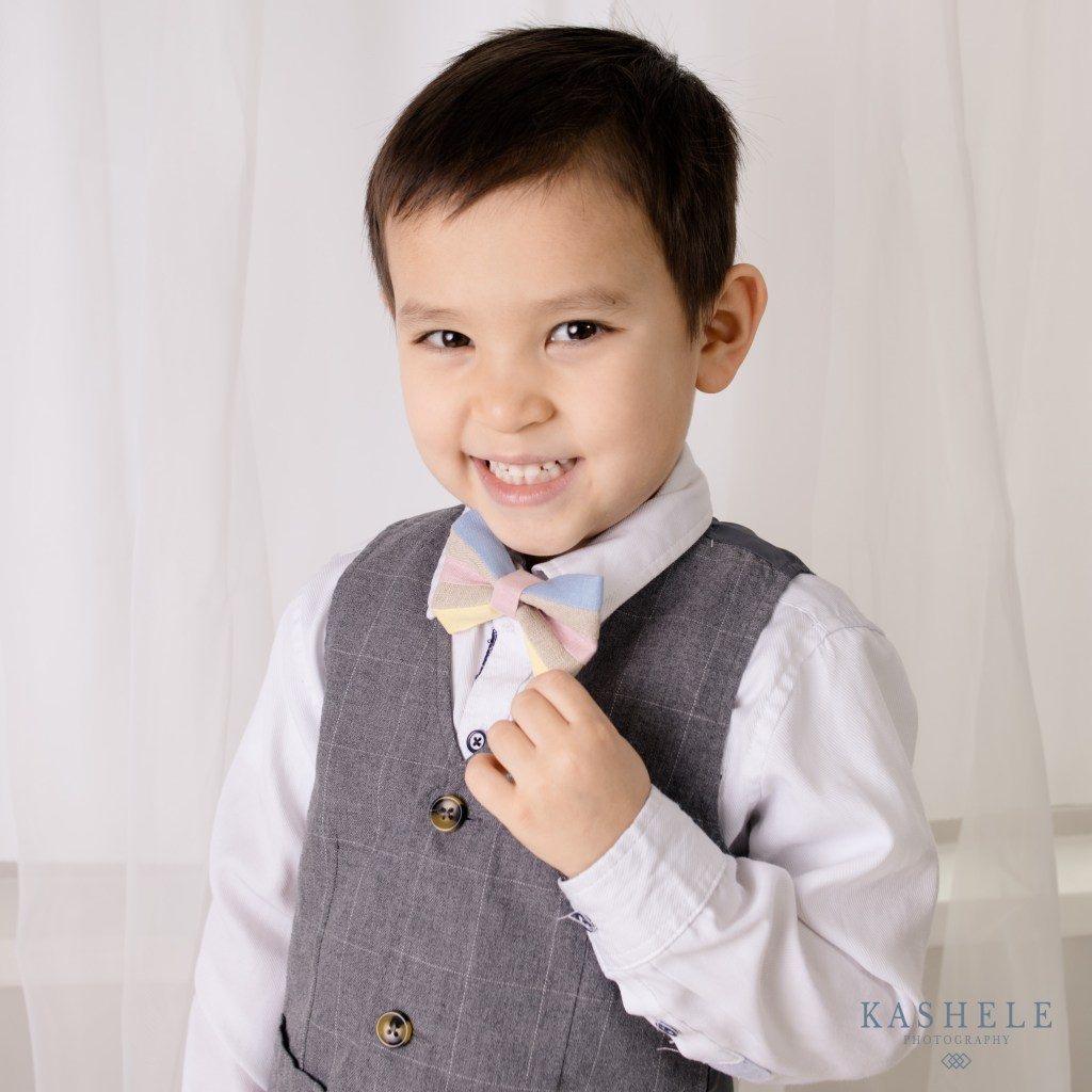 Commercial Product Photography Standard image of little boy modeling a bow tie