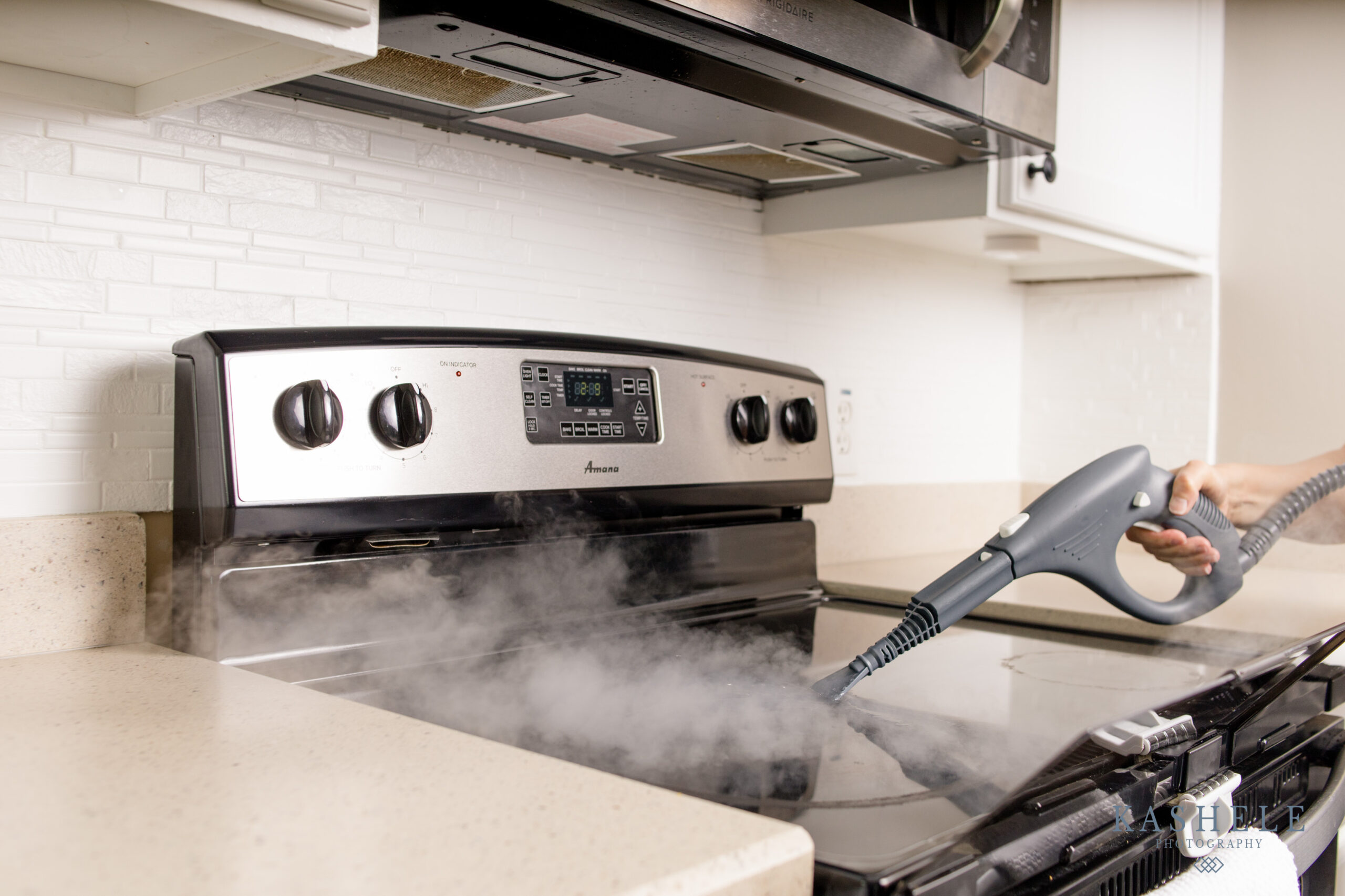 Lifestyle image of steam cleaning on a stovetop