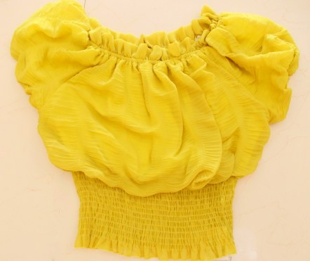 Code 101: Bubble top with lining. Stretchable with elastic band at waist and puffed sleeves. Price: Rs. 1350/-
