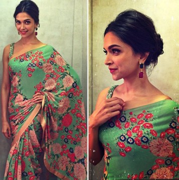 Deepika Padukone in a green saree with a pretty pattern that contrasts. Hair pulled back just highlights the look