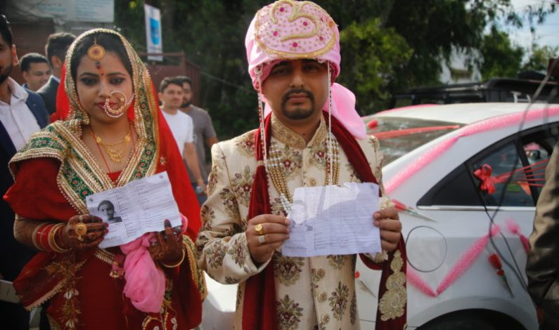 'Just Married' couple reaches polling booth to vote in Udhampur in Jammu and Kashmir