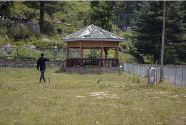The entry fee to the Aharbal waterfall is only 10 Rs per person and yet people try to trespass. An official of the Aharbal Development Authority chasing away a boy who was trying to enter through the fences. (Photo:- Umar Farooq for The Kashmiriyat)