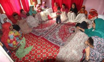 a group of women yarning pashmina (FUMB) in a remote village of baramulla district .majority of women yarns pashmina to earn peanut amount to support their respective families