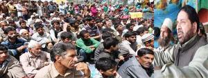 Hakeem Yaseen addressing a public rally on Saturday in Odumpur