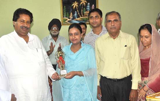 Raman Bhalla felicitating Neha Sharma in Jammu.