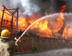 A Fireman in action to douse flames that erupt in Civil Secretariat building on Thursday morning: Photo: Bilal Bahadur