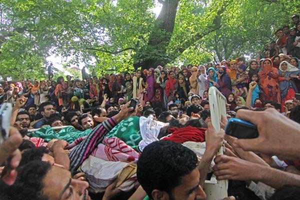 Shahnawaz's body was taken around the village before he was laid to rest at his ancestral graveyard in Dadsar village.