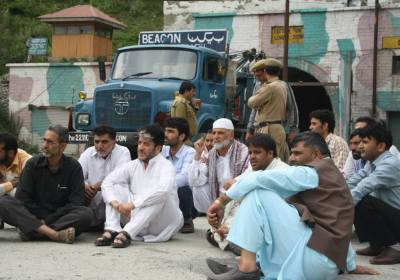 Shabir Shah sitting in protest after police foiled his Gool visit Wednesday