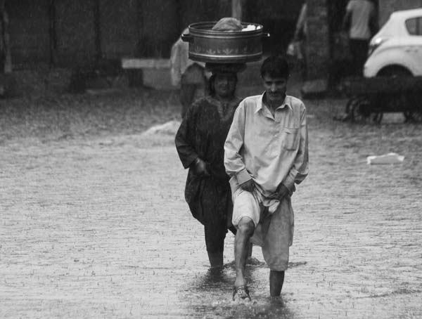 Rainy Resolve: Obviously, it one more day of shower, but is weather-wetting enough to hold back to secure one's bread? Nay! We know it for sure that fisherwoman is all weather street-face of valley.