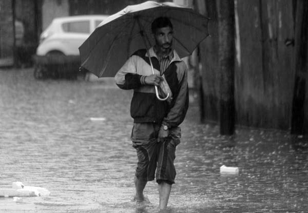 Flooded Footing: And who says, we never drench. Shall we remind them that drenching is our only legacy. We heard Wits asserting that silhouettes never vanish. True, they won't. And could they? They can't be so forgiven. So, we stroll, even if, downpour keep drenching us and plague our alleys.