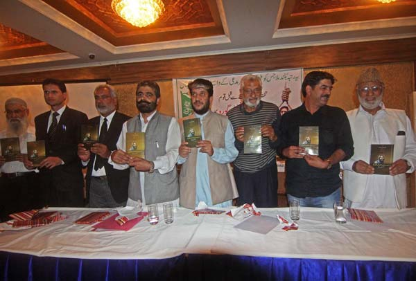 Nayeem Khan and Shabir Shah releasing Afzal Guru's memoir during a function in Srinagar.