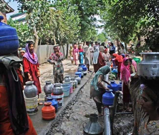 """Community Tapping: Locals blame that areas around these taps have become source of water borne diseases. This year the Sonawari belt saw out break of Hepatitis-B. Interestingly there is no primary health centre in the area. The doctors who visited these villages, besides other things advised locals to drink boiled water. """"We have to go to Sumbal hospital or Pattan for the treatment,"""" says Showkat."""