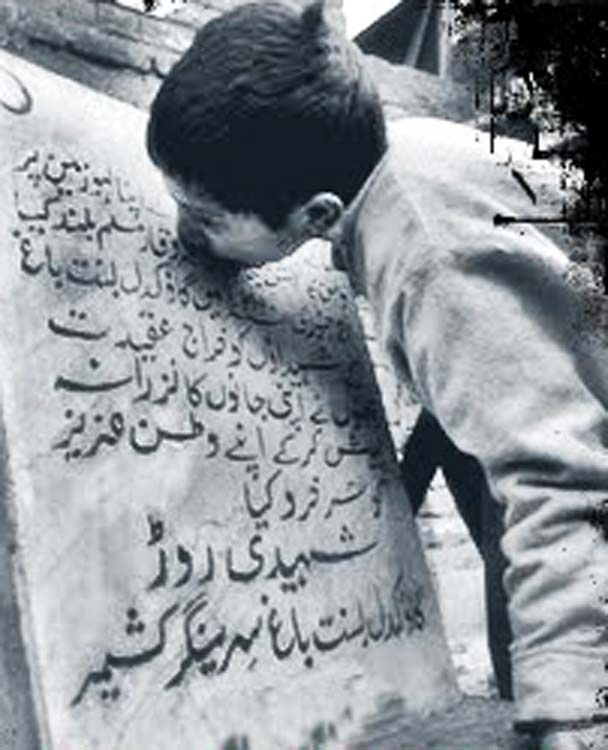 Boy kisses the stone bearing the record of the massacre in Gaw Kadal.
