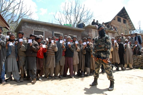 Voters showing identity proofs outside the polling station in south kashmir's hiller village.