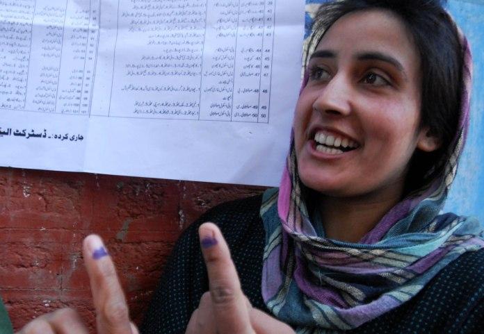 A girl showing voting mark on her finger after she casted her vote in south kashmiris hiller village.
