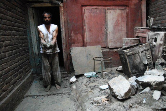 The flood left behind mud all over this man's home.