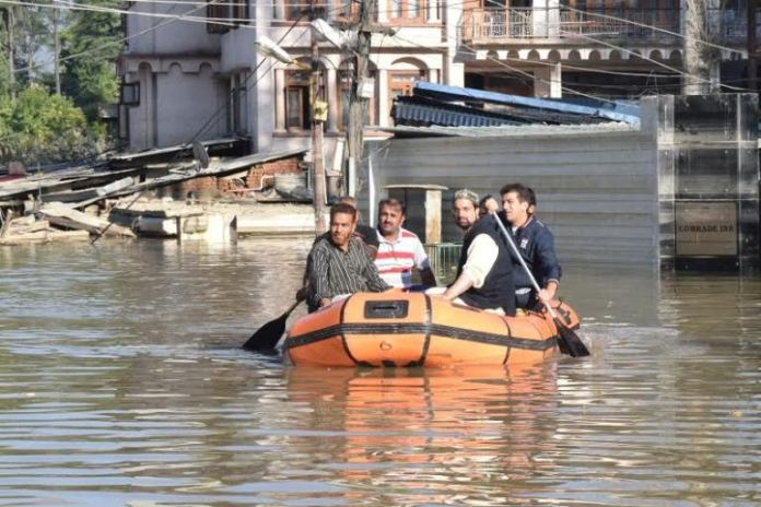 Mirwaiz Umer Farooq in action, visiting flooded areas