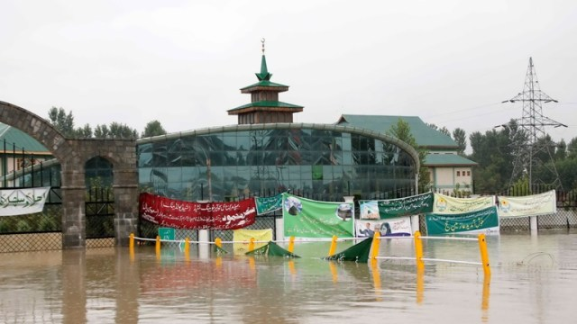 Water spilled over from Doodh Ganga stream behind the Kashmir Hajj House near Bemina.