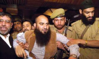 A file KL Image of Masarat Alam being arrested in 2010 uprising.