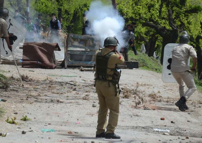 Policeman had to resort to tear-gas shelling to disperse protesters.