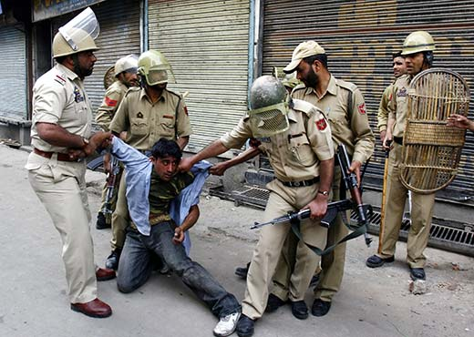 A youth being taken into custody during protests in this file photo. Pic: Bilal Bahadur