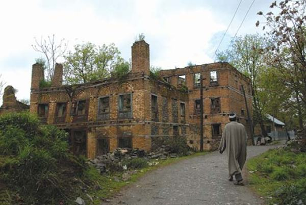 Mohammad Sultan nearby abondoned pandit houses in Wandhama. Pic: Bilal Bahadur