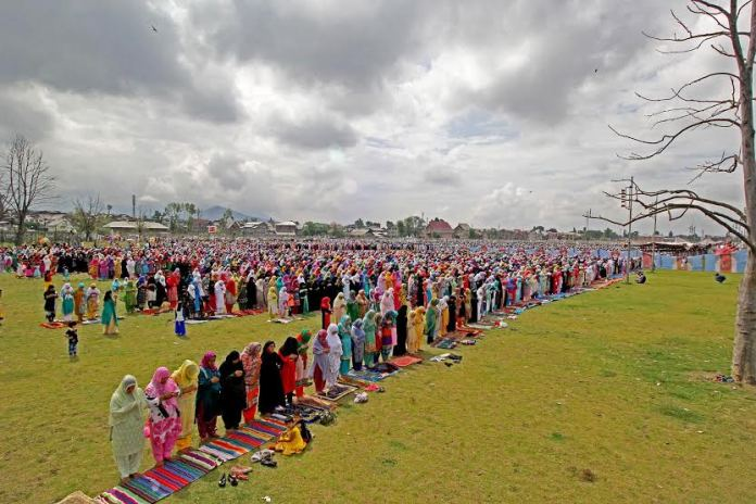 Women devotees offering Namaz on the occasion of Eid-Ul-Fitr at Eid Ghar srinagar on Saturday 18 July 2015PHOTO BY BILAL BAHADUR
