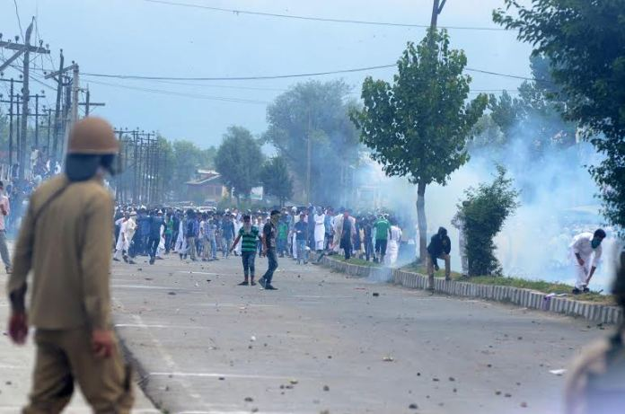 Kashmiri Muslim protesters clash with Police after Eid-ul-Fitr at Eidgah in Downtown on 18 July 2015in Srinagar,. Police fired teargas shells and baton-charged the protestors to disperse them. Eid-ul-Fitr marks the end of Ramadan, PHOTO BY BILAL BAHADUR