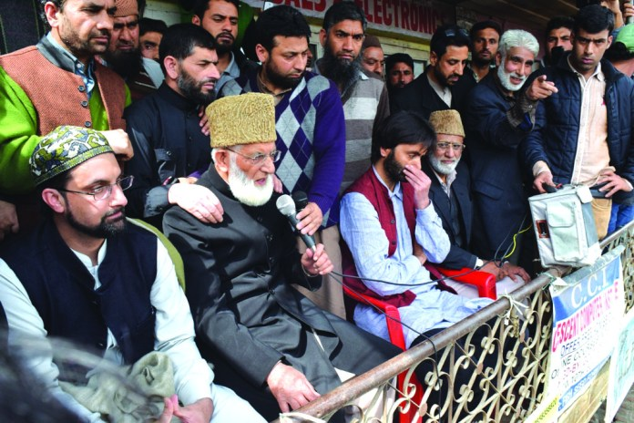 (LtoR) Mirwaiz Umar Farooq, Syed Ali Geeani, Muhammad yasin Malik and Muhammad Ashraf Sehrai addressing a rally at Narbal in the outskirts of the Srinagar city jointly for the first time since 2008.