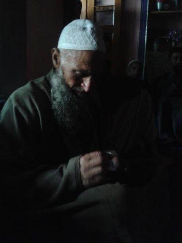 Muzamil's father.