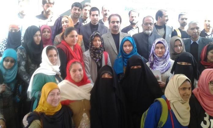 Some of the toppers posing for pictures with Dr Shah Faesal and others.