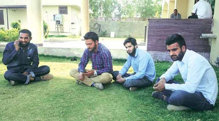 Saqib Ashraf, Mohd Maqbool, Shaukat Ali Butt, Hilal Ahmad on campus. (The Indian Express Photo)
