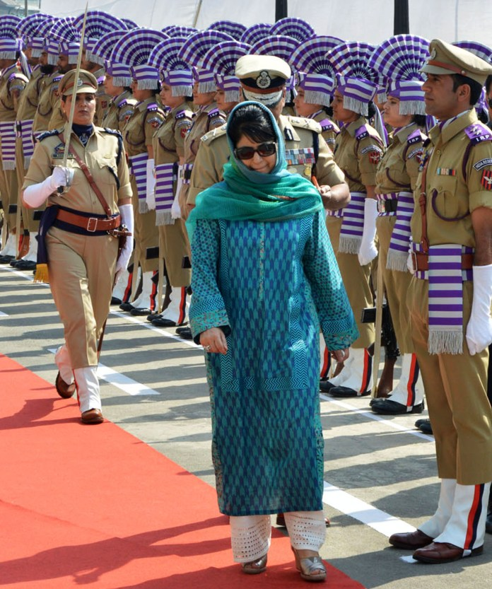 Jammu and Kashmir Kashmir Chief Minister, Mehbooba Mufti inspects a guard of honor in the Civil Secretariat compound during the opening of offices as part of the Darbar Move. (KL Image: BILAL BAHADUR)