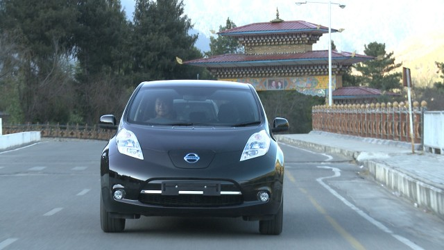 An electric Car plying on a Bhutan road.