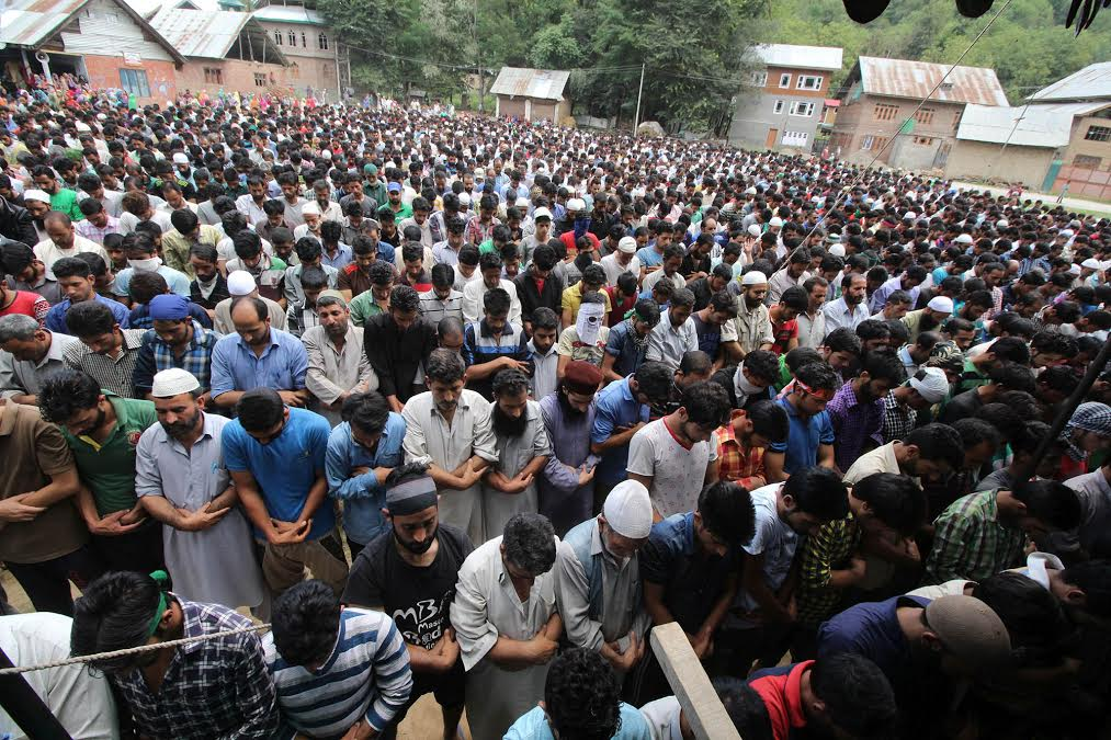 People offer funeral prayers to the slain persons Aaripanthan area in central Kashmir's Budgam district on Tuesday, August 16, 2016PHOTO BY BILAL BAHADUR