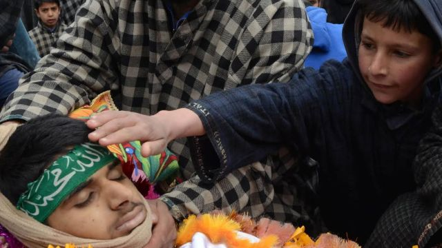 A Kashmiri Muslim villager kisses the body of Amir Nazir during his funeral at Begumbagh Kashmir Thursday, March. 9, 2017. Nazir, 15, was killed Thursday during protest PHOTO BY BILAL BAHADUR