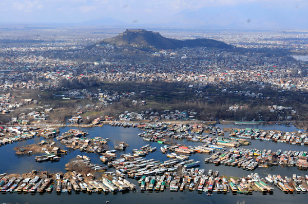 An aerial view of Srinagar city including parts of world famous Dal lake in Srinagar on Wednesday, as sun came out for the first time this week afrer rains lashed Kashmir valley and snow on the hills. The sun brought respite to the people from the cold wave.
