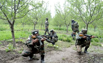A file pic of army personnel in action during a search operation in Shopian. Caveman in Folklore - Diary - Conflict - Issue 04 - Vol 10 - kashmir Life