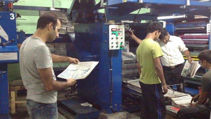 Kashmir Life team at printing press.