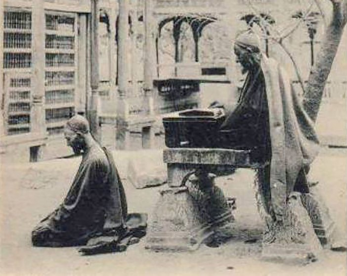 An undated photograph of early nineteenth century showing people praying in a Srinagar shrine.